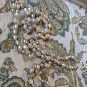 Single strand of freshwater pearls knotted 62""